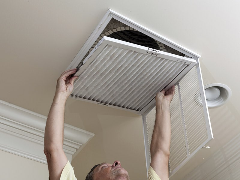 Changing air filter to improve indoor air quality (IAQ)