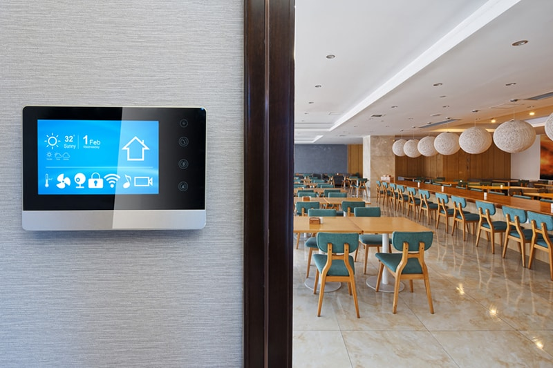 smart screen on wall in modern cafeteria, It's Easy to Make Your Home Smarter | Smart Thermostats in Savannah