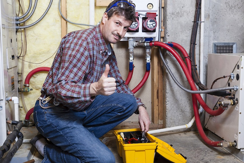 An HVAC Technician giving the thumbs up during maintenance, Don't Neglect Your Commercial HVAC System | AC, Furnace, Pooler, GA